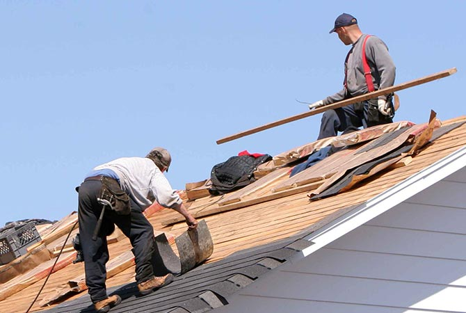 Men putting a new roof on a home