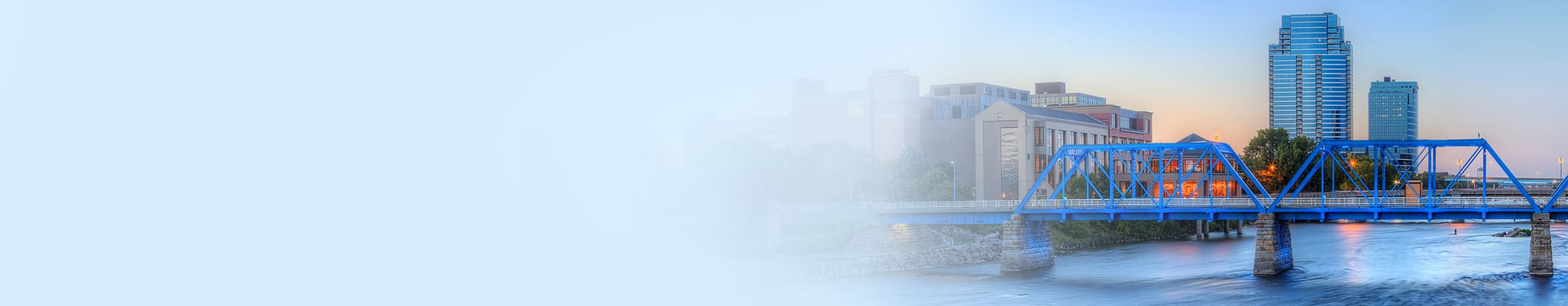 Business Leaders image, cityscape photo of grand rapids looking over blue bridge
