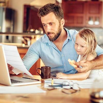 Dad and daughter looking at retirement paperwork