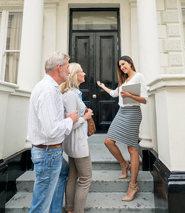 Realtor Showing Older Couple New Home