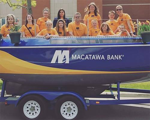 Macatawa Bank employees in Tulip time parade float