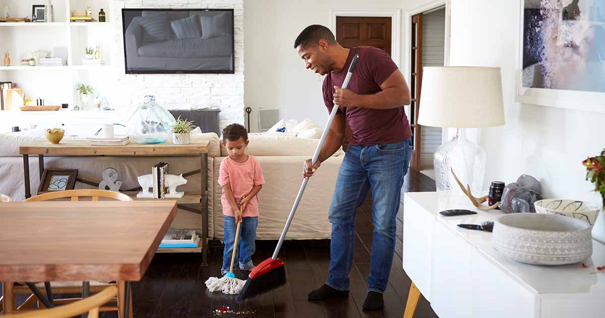 Man cleaning his house with his son