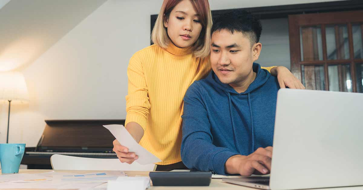 Young couple looking at home financing options